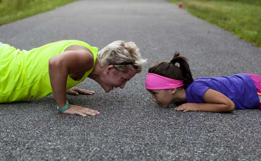 Mother and daughter exercising together.