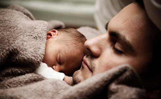 Father and baby sleeping.